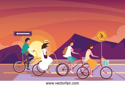 people riding bike in sunrise landscape with signage for cyclist