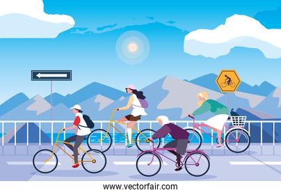 people riding bike in snowscape with signage for cyclist