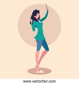 young woman taking selfie with smartphone device