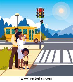 parents afro with boy waiting school bus