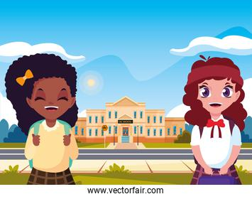 little students girls front of school building
