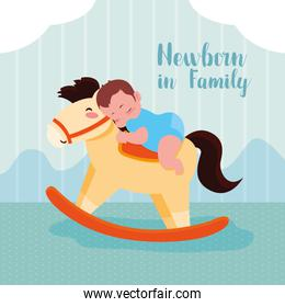 newborn card with baby boy and wooden horse