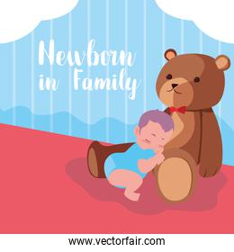 newborn in family cartel with baby boy sleeping and teddy bear
