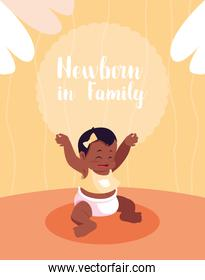 newborn in family card with afro baby girl