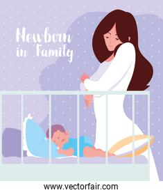newborn in family card with mom and baby sleeping in crib