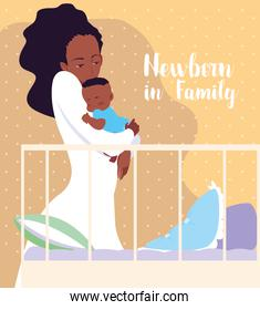 newborn in family card with mom afro and baby sleeping in crib