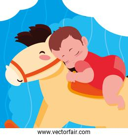 baby boy sleeping in wooden horse