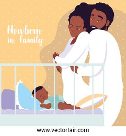 newborn in family with parents afro and boy sleeping in crib