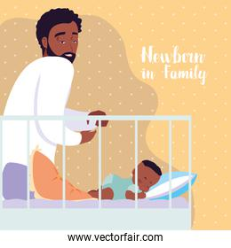 newborn in family card with dad afro and baby sleeping in crib