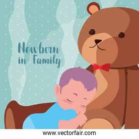 newborn in family card with baby boy sleeping and teddy bear