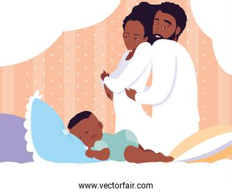 parents afro with baby boy sleeping