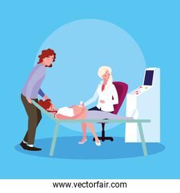 mother in stretcher performing ultrasound