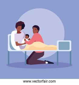 smiling mother afro with newborn in stretcher and father observing