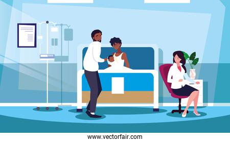 parents with newborn in stretcher hospitalization room