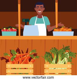 salesman with stall kiosk of store vegetables
