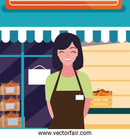 saleswoman with fresh fruits store facade building