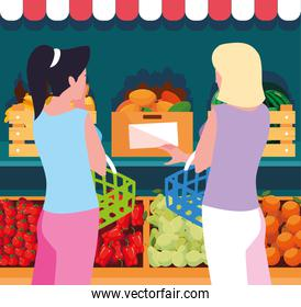 buyer women with showcase wooden store with vegetables