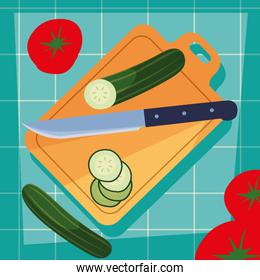 kitchen board with vegetables and knife
