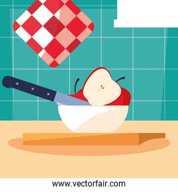 kitchen board with apples in bowl and knife