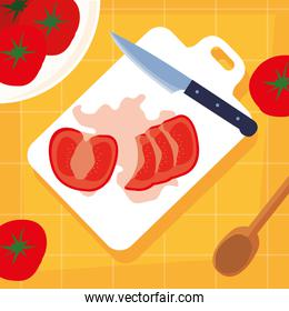 kitchen board with tomatoes and knife