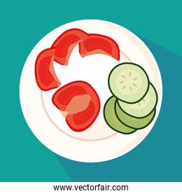 dish with slices of cucumber and tomatoes