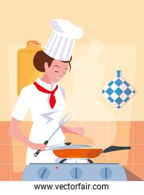 professional chef female in kitchen cooking