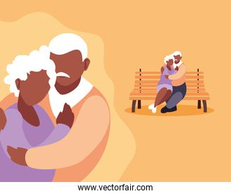 cute old couple seated in chair of park and hugged