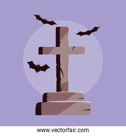 tombstone in cross shape and bats flying