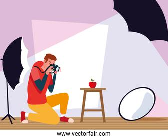 man with camera in photo studio