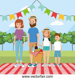 family picnic with basket food and tablecloth