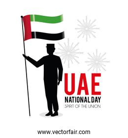 soldier with uae flag to national day