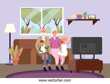 old woman and man with kids in the sofa