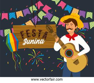 man with guitar and party banner with fireworks