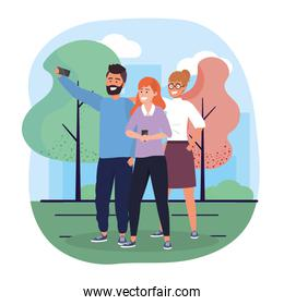 women and man friends with smartphone and trees