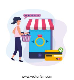 woman with shopping basket and shopping with smartphone and credit card