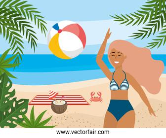 woman play with beach ball and coconut beverage with towel