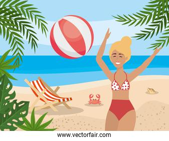 woman play with beach ball and tanning chair with crab