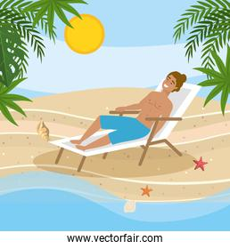 man wearing bathing shorts and taking sun in the tanning chair