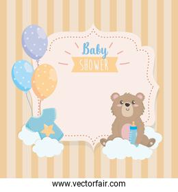 label of teddy bear with feeding bottle and clouds