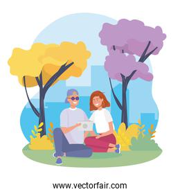girl and boy couple with bushes plants and trees