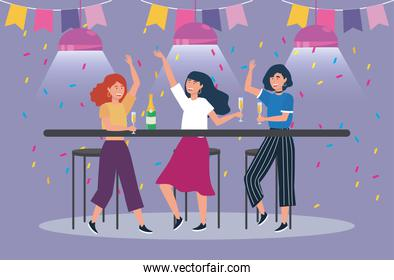 women dancing with party banner and champagne glass