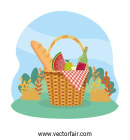 hamper with bread and watermelon with wine bottle