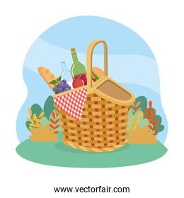 hamper with bread and wine bottle with grapes and hamburger