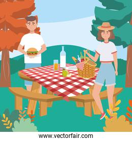 woman and man with hamburger and milk bottle with bread