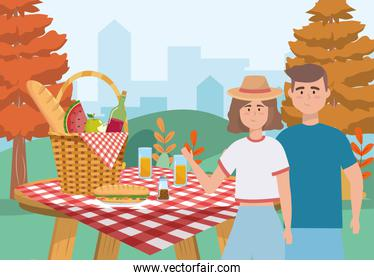 woman and man couple with hamper and food