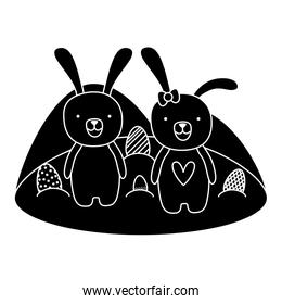 silhouette couple rabbit animal with eggs easter