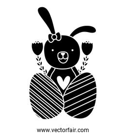 silhouette rabbit female with flowers and eggs easter