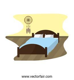 comfortable bed with pillow object and dream catcher