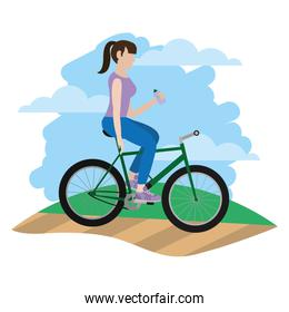 woman side bike and drinking water in the landscape