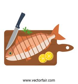 chopped fish with lemon and knife in the cutting board